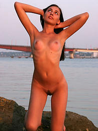 Breathtaking nude angel is seen to pose in front of the huge bridge in the river very naturally without any shade of shame. pictures at find-best-videos.com