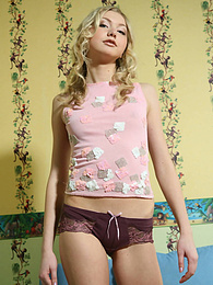 Blonde exciting teen decided to have some fun in her comfortable room and for that purpose she takes off all clothes. pictures at freekilosex.com