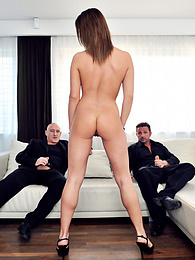 Kitty Kat receives a nasty DP from two cocks and enjoys it pictures at freekilosex.com