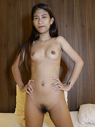 Cute Thai student with rock-hard tits and hairy pussy lets stranger cum inside her pictures