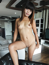 Beautifully thin Asian MILF bears down on long white cock pictures at lingerie-mania.com