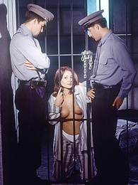 Stunning Vanda Has a Threesome in Prision with the Cops pictures