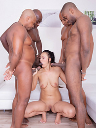Hungry Brunette Loves it in a Gangbang with Four Black Studs pictures