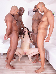 Hannah Vivienne in pigtails debuts with interracial gangbang pictures at freekilomovies.com