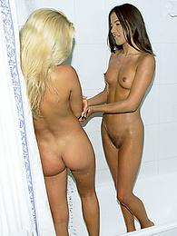 Two cute teens share cock after playing under the shower pictures at freekilomovies.com