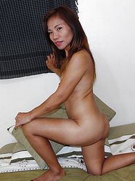 Asian MILF handjob expert with Kung-Fu grip pictures at find-best-lingerie.com