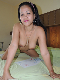 Amateur Filipina babe shows off her big tits for the cam pictures at freekilomovies.com