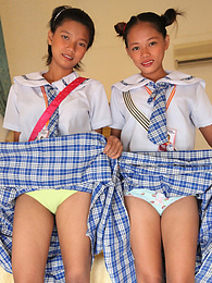 Two cute young Filipina schoolgirls strip naked to show pussy pictures