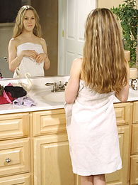 Stunning little blonde girl getting dressed pictures