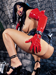 Hot Lucy Love in red vinyl gloves enjoys a dungeon session pictures