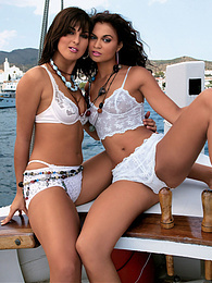 Two goegeous brunettes sailing wet pussies and hard cocks pictures