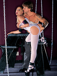 Blonde in stockings and corset has sex with a tattooed guy pictures at freekilosex.com