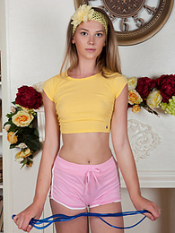 Amazing and breath taking beauty gets off her yellow shirt and pink shorts and poses in sexy socks. pictures at find-best-lingerie.com