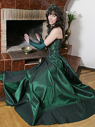 Regal-looking awesome brunette wearing a splendid evening dress exposes her nude gorgeous breasts and dazzling beauty pictures at kilogirls.com
