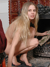 Cutie strips near a fireplace feeling hot because of fire and excitement overwhelming her pictures at kilomatures.com