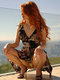 Hot redhead getting naked on her balcony pictures at find-best-ass.com
