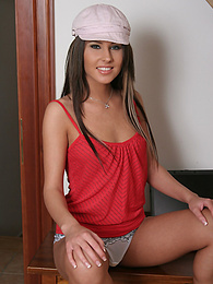 Zuzanna wears a cap and poses her sexy body pictures at freekilomovies.com
