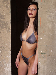 Sultry brunette in an industrial setting pictures at find-best-hardcore.com