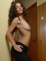 Ukrainian brunette slowly strips pictures at kilovideos.com