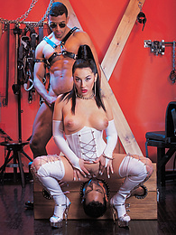 Carmen loves her white latex outfit and her black stallions pictures at freekiloclips.com