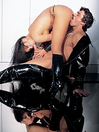 Asian pornstar Katsumi takes her latex slave for a ride pictures at freekilomovies.com