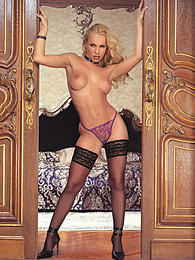 Blonde Slut Jodie Moore in Stockings Invites You To Her Bed pictures at kilopills.com