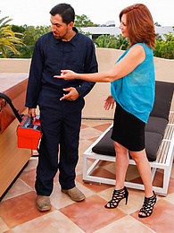 Older mature babe Andi James gets fucked on roof by repair man pics