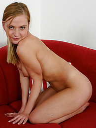 Braces wearing babe Petra strips naked on the red couch pictures