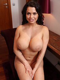 Busty and curvy brunette babe Chloe Lamoure strips naked pictures at freekiloclips.com