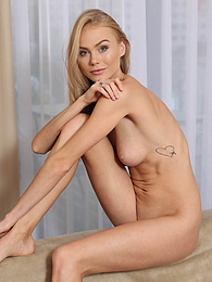 Tall blonde babe Nancy Ace naked in only her black stilettos pictures at kilogirls.com