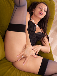 Brunette MILF Vicky Love masturbates while wearing black stockings pictures
