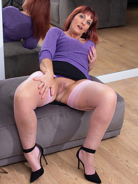 Older redhead Beau Diamonds spreads her pink stocking covered legs pictures
