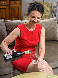 Mature babe Anette Harper toys pussy after a glass of wine pictures at freekilosex.com