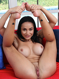 Busty MILF Crystal Rush with her legs behind her head pictures at kilovideos.com