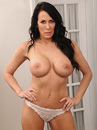 Busty and curvy MILF Reagan Foxx chews on her panties pictures at find-best-tits.com