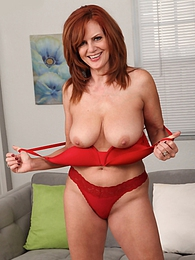 Sexy older redhead Andi James strips off all her clothes pictures