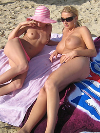 MILF threesome outdoors with a dick and a strapon pics