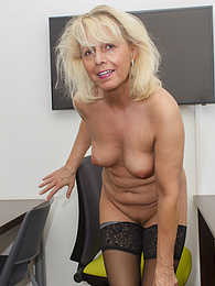 Horny mature amateur Martina K strips butt ass naked at her desk pictures at kilogirls.com