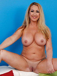 Tattooed and busty mature babe Janna Hicks strips naked pictures at kilovideos.com