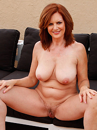 Busty mature redhead Andi James gets butt naked on the roof pictures at freekiloporn.com