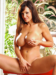 Busty mature porn superstar Lisa Ann exposes her lovely pussy pictures at kilovideos.com