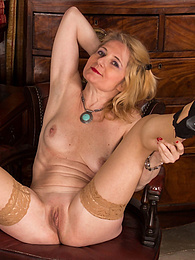 Stocking wearing mature woman Lily Roma is butt naked on her desk pictures at kilogirls.com