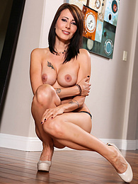 Mature redhead Zoey Holloway shows off her hidden body tattoos pictures at kilovideos.com