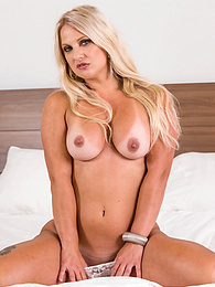 Busty cougar Caroline De Jaie shows off her tats and tan lines pictures at find-best-hardcore.com