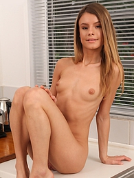 Skinny babe Asuna Fox uses an ice cube on her naked body pictures at freekilomovies.com