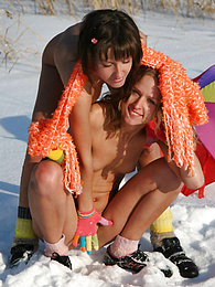 Extremely attractive kittens are playing on the snow fully nude and warm themselves with hot kisses. pictures at freekiloclips.com