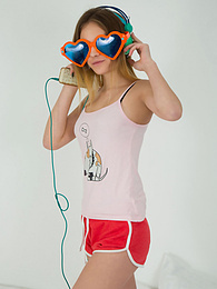 This doll really knows how to have fun with her and how she can show off her pussy and listen to some beats at the same time. pictures at freekiloporn.com