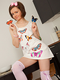 Beautiful brunette angel in adorable clothing is posing for the camera to show her petite but feminine features to the public. pictures at kilomatures.com