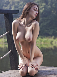 Vigorous feminine beauty with huge natural breasts is wearing sexy tight clothing while enjoying her and the nature. pictures