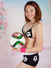 Soccer loving dark haired girl has delicious discrete tits and smooth legs which are slowly getting uncovered in a relaxing room. pictures at dailyadult.info